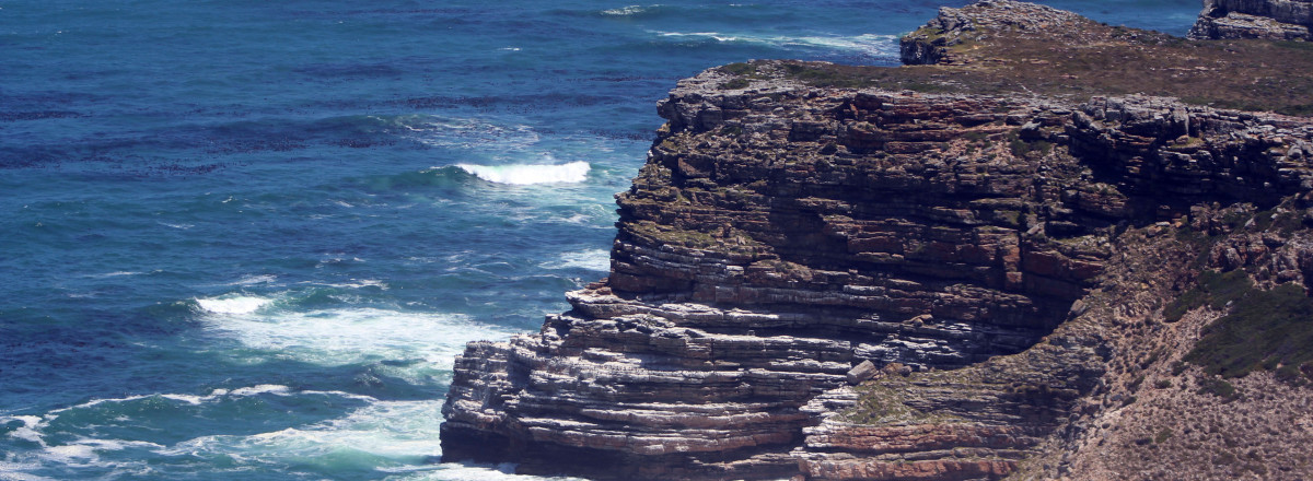 Sandstone cliffs that overlook the sea at Cape Point, with the sea buffeting against the cliffs, this is a sight to be seen and enjoyed.