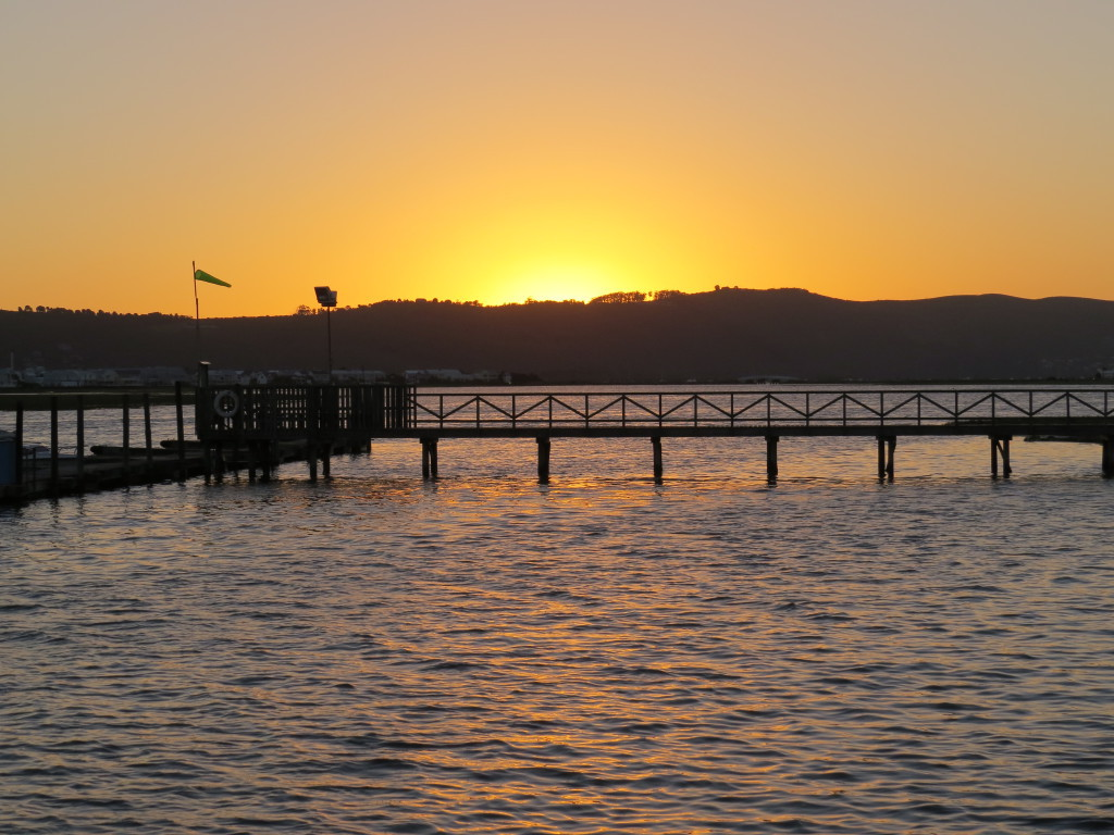 Knysna River Club, photo of the sky with sunsets and the water with the pier's
